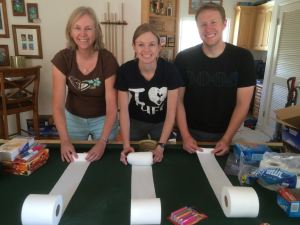 Sandy, Marissa and Jon Rolling Out Half Rolls of TP for the PCT. (Click Image for Larger View.)