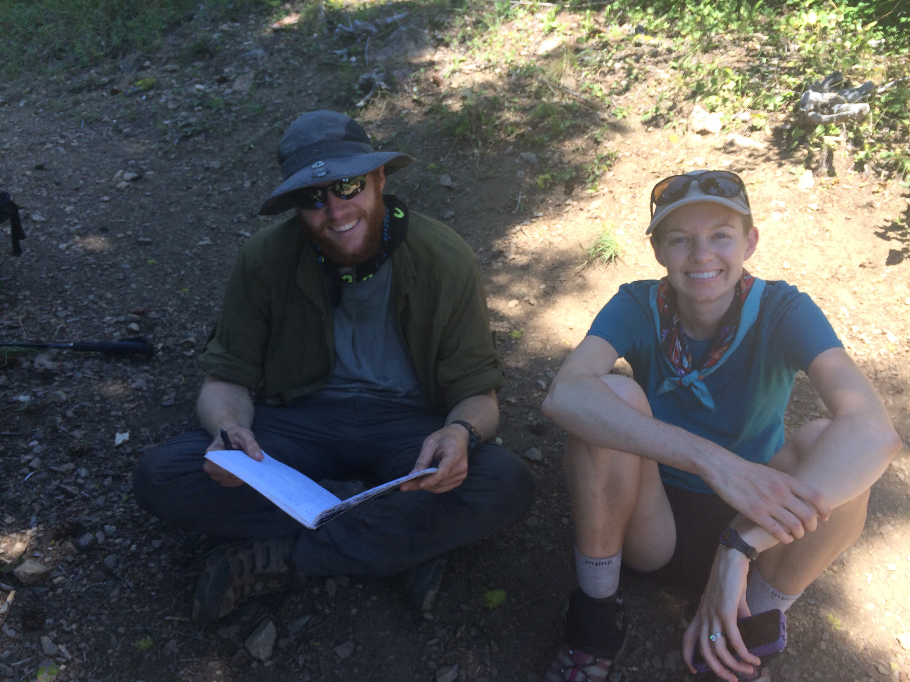 Smiles and Lizard reading some entries in the trail register at the CA/OR border.