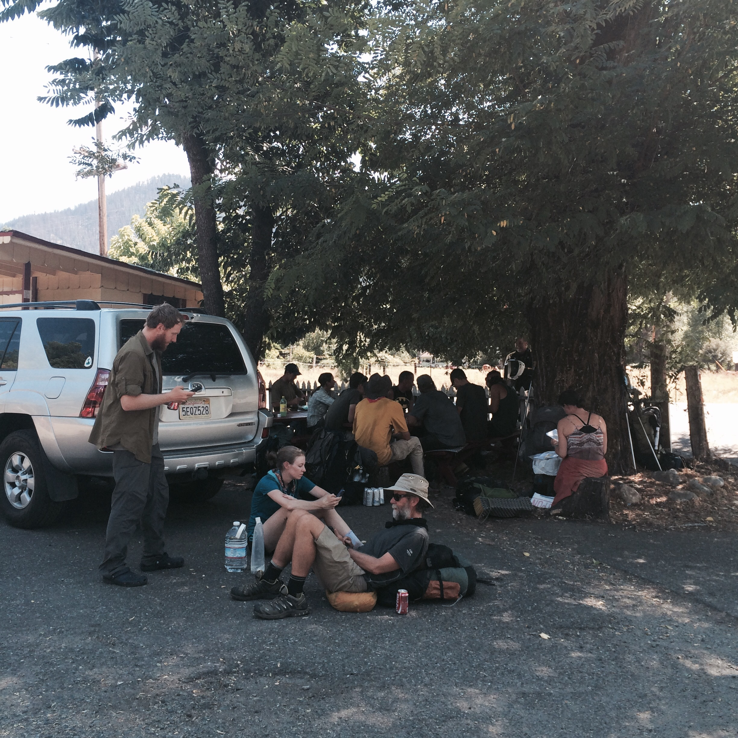 Hikers waiting out the heat outside the Seiad Cafe